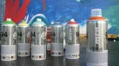 Cans with aerosol spray-on paint stands on floor Stock Footage