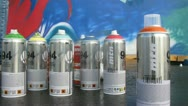 Stock Video Footage of Cans with aerosol spray-on paint stands on floor
