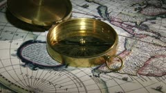 Gold compass, candle, old map Stock Footage