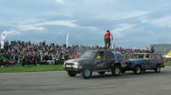 Stuntmen show stunt on cars on super-show Stock Footage