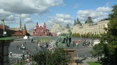 People walk across Red Square near GUM in sunny day Stock Footage