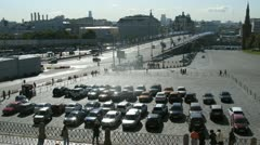 Cars stand near Big Moskvoretsky Bridge on parking Stock Footage
