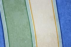 Water drips on colorful fabric - stock photo