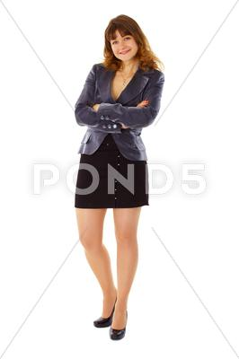 Stock photo of young woman in business suit smiling