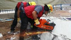 Stock Video Footage of Firefighter cuts steel to rescue earthquake casualty victims