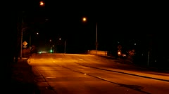 Night traffic on a city street with overpass - stock footage