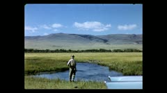 Montana fishing by the car 1957 Stock Footage
