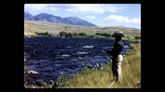 Boy fly-fishing in Montana, 1957 - stock footage