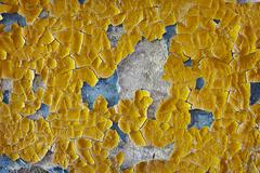 Cracked oil enamel on an old wall - background Stock Photos