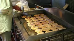 Commercial kitchen grill cooking chicken breasts Stock Footage