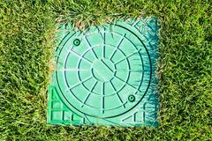 Hatch of the storm water drain Stock Photos