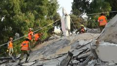 Soldiers search for earthquake casualties digging through the rubble Stock Footage