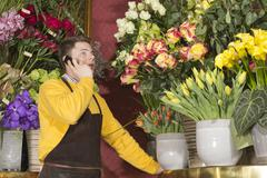 Florist accepting phone order - stock photo