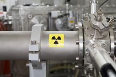 Vital electronic parts of ION Accelerator, warning high radiation Stock Photos