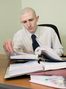 Bookkeeper on a workplace at office Stock Photos