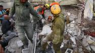 Stock Video Footage of Rescue soldiers carry on stretcher earthquake victim to hospital
