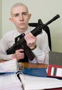 accountant armed with a rifle - stock photo