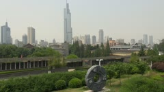 Fast motion of Skyline of Nanjing with Zifeng Tower, Nanjing, China Stock Footage