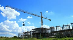Building crane against blue sky and cloud running Stock Footage