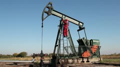 Oil Worker Turning Valve On Oil Rig - stock footage