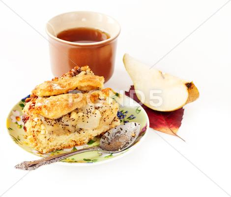 Stock photo of apple and pear pie with a cup of tea