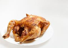 Roasted chicken isolated on a white Stock Photos