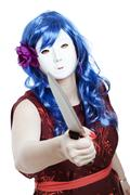 Scary masked woman with knife Stock Photos