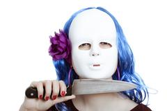 horror masked woman with knife - stock photo