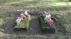 Two ancient All Soul's Day grave in  cemetery Stock Footage