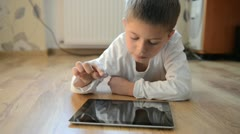 Child playing on a tablet pc - stock footage