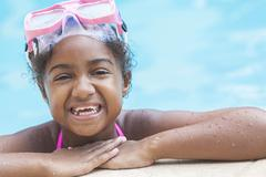 African american girl child in swimming pool with goggles Stock Photos