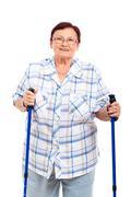 happy senior woman with walking sticks - stock photo