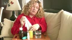 Sick women using a nasal spray - stock footage