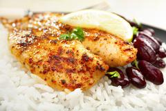 Grilled white fish dory with spicy creole cajun rub Stock Photos