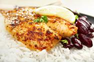 Stock Photo of grilled white fish dory with spicy creole cajun rub
