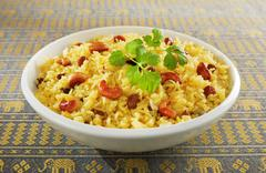 indian rice pilau in white bowl - stock photo