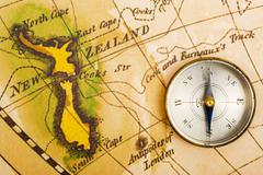 ancient map and compass - stock photo