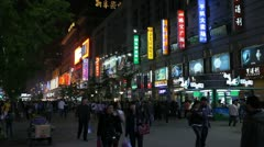 Silver Street Famous Shopping in Beijing, China, Neon Lights by night, Shoppers Stock Footage