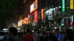 Famous Shopping Silver Street in Beijing, China, Neon Lights by night, Shoppers Stock Footage