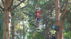 Child Climbing in the Forest, Adventure Park, Children, Extreme Sport Stock Footage