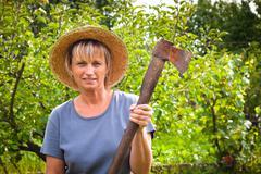 Woman with axe Stock Photos