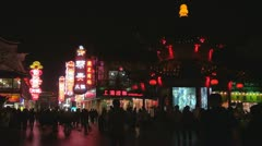 Nanjing shopping street night Nanjing China crowd people neon sign shop busy Stock Footage