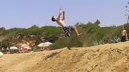 Stock Video Footage of Freerunning stunt Cork (backflip 360 ) from a sand hill