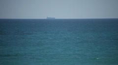 Distant Ship Sails on Horizon over Water Stock Footage