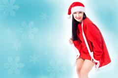 Attractive christmas girl background Stock Photos