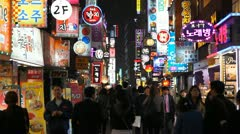 Seoul Night Neon Busy Crowd Shopping Street Electronic Asian Shopper South Korea - stock footage