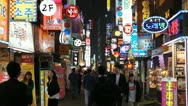 Stock Video Footage of Seoul Neon Street Electronic by night, Asian Shopping, Shoppers in South Korea