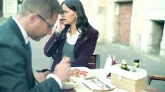Business people eating dinner and talking in the restaurant, outdoor Stock Footage