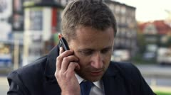 Businessman getting bad news on cellphone, slow motion shot at 240fps Stock Footage