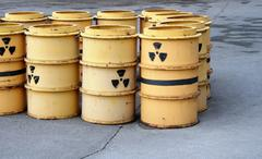 Rusty and old barrel with radioactive waste Stock Photos